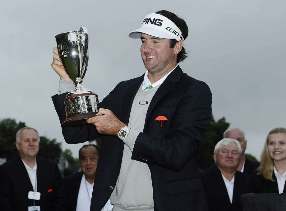 Bubba Watson holds the championship trophy after winning the Travelers Championship golf tournament, Sunday, June 28, 2015, in Cromwell, Conn.  Watson beat out Paul Casey in a playoff. Watson will return to defend his title this August. Photo: AP FILE PHOTO   / FR125654 AP