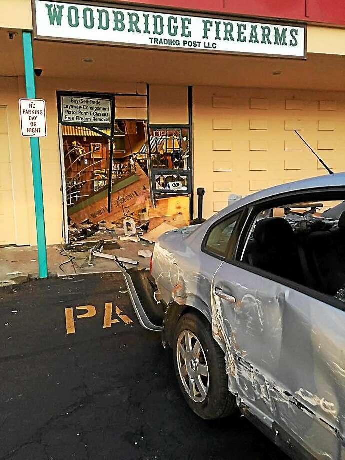 Woodbridge police said multiple suspects smashed a silver sedan into Woodbridge Firearms Trading Post on Selden Street in June 2015. Photo: CONTRIBUTED PHOTO — Matt Majewski