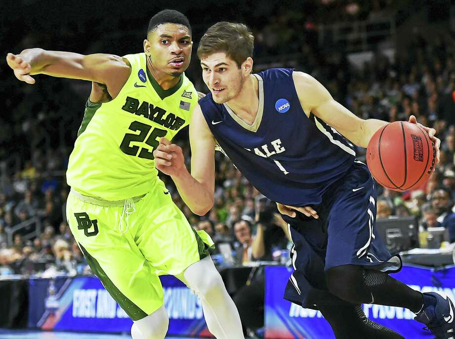 Yale junior guard Anthony Dallier, driving to the basket in the Bulldogs win over Baylor in the first round of the NCAA tournament this past March, has been elected the team's captain. Photo: Catherine Avalone - Register   / New Haven RegisterThe Middletown Press