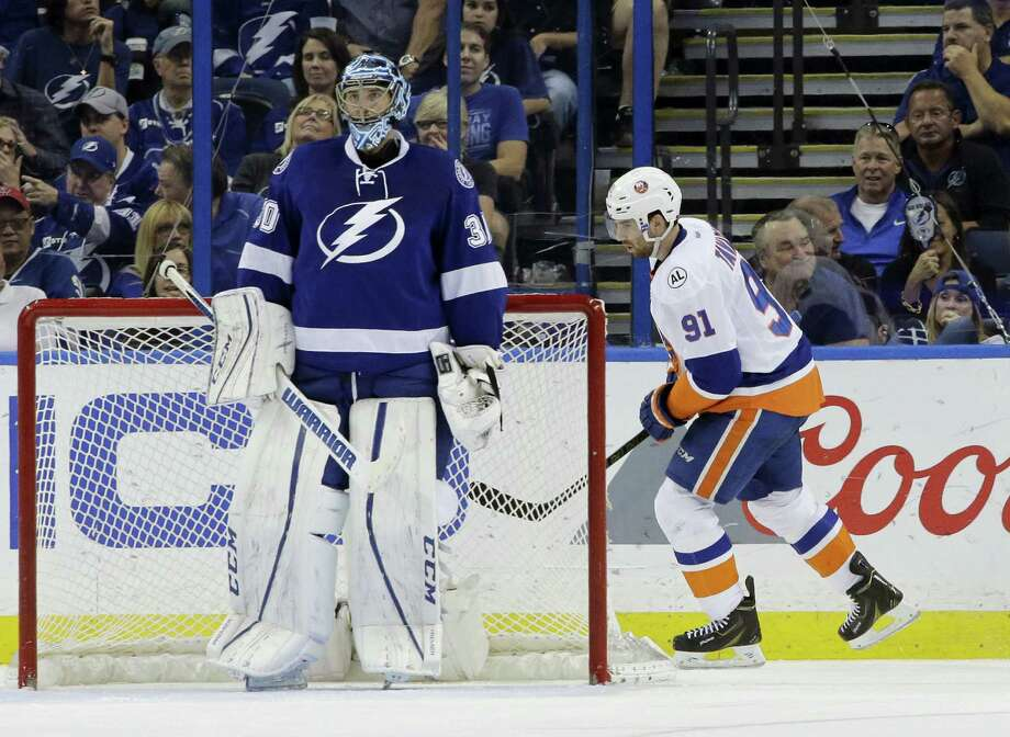 New York Islanders' John Tavares (91) skates behind Tampa Bay Lightning goalie Ben Bishop (30) after Tavares scores the fourth New York Islanders goal during the second period of Game 1 of the NHL hockey Stanley Cup Eastern Conference semifinals Wednesday in Tampa, Florida. Photo: The Associated Press   / AP