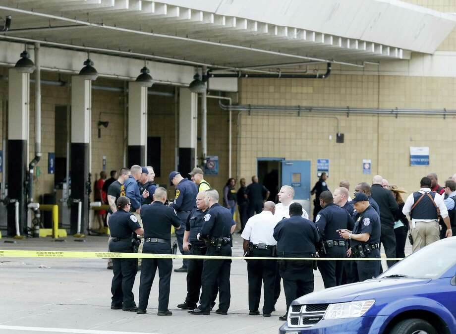 Police officers gather outside the Greyhound Bus Station in Richmond, Va. Thursday, March 31, 2016, after a shooting inside the terminal. Virginia State Police said at least two troopers responding to a shooting at a Richmond bus station and a civilian have been taken to a hospital. Spokeswoman Corinne Geller said the shooting suspect was in custody Thursday afternoon. Photo: Dean Hoffmeyer — Richmond Times-Dispatch Via AP / Richmond Times-Dispatch
