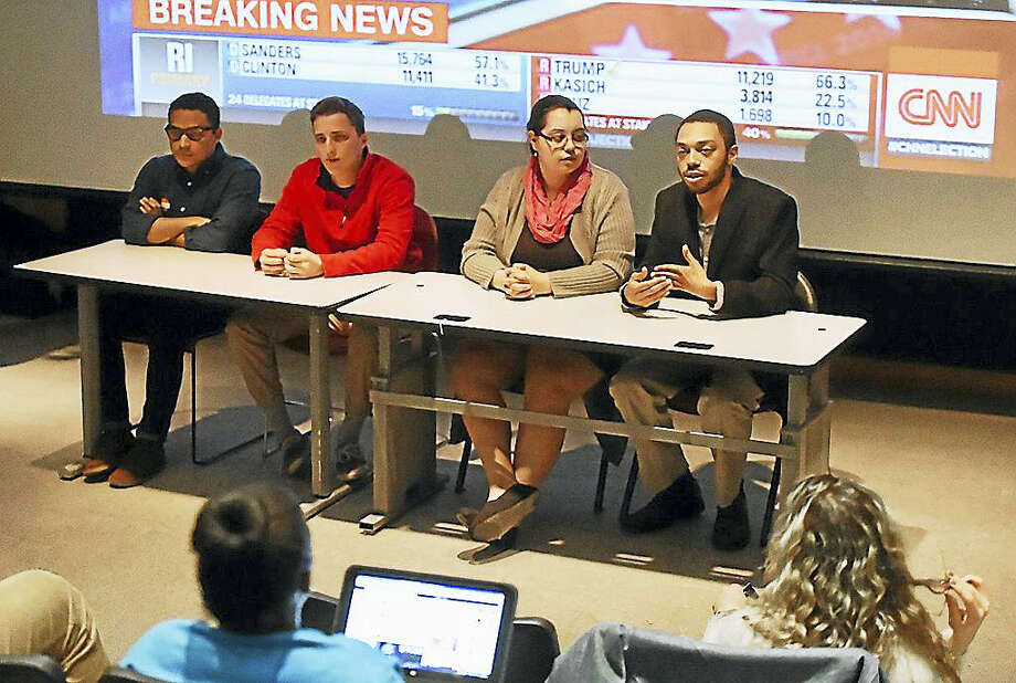 College Democrats at Southern Connecticut State University hosted a primary election viewing party and panel Tuesday night at Engleman Hall. Junior Corey Evans (far right) says although he voted for and supports Bernie Sanders, he will support Hillary Clinton if she is the Democratic candidate. At center right, is junior Mishele Rodriguez, who also supports Bernie Sanders. Photo: Catherine Avalone — New Haven Register   / New Haven RegisterThe Middletown Press