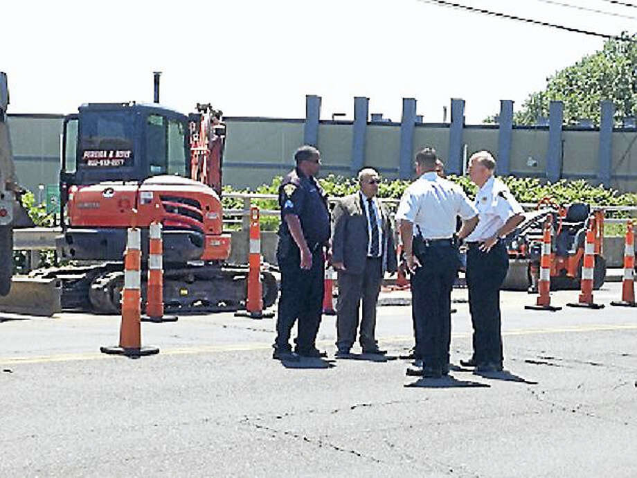 The scene of a fatal construction accident at the West Haven-New Haven border. New Haven Assistant Police Chief Achilles Generoso is at center left, and New Haven Chief Dean Esserman is at far right. Photo: Mark Zaretsky — New Haven Register