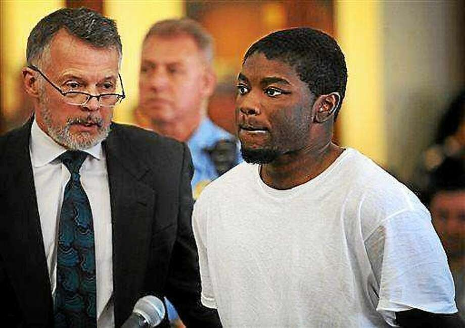 In this file photo, Jermaine Richards, right, standing with his lawyer, John R. Gulash, is arraigned on murder and kidnapping charges in the death of Eastern Connecticut State University student Alyssiah Marie Wiley at Superior Court in Bridgeport on Monday, May 20, 2013. Photo: AP Photo — Connecticut Post, Brian A. Pounds, Pool