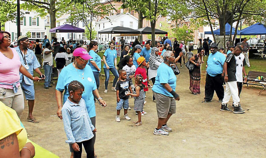Children and adults get together at last year's Hill event. Photo: Arts & Ideas Photo