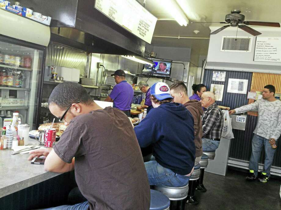 The scene in Nick's Luncheonette on First Avenue in West Haven Thursday. Photo: MARK ZARETSKY — NEW HAVEN REGISTER
