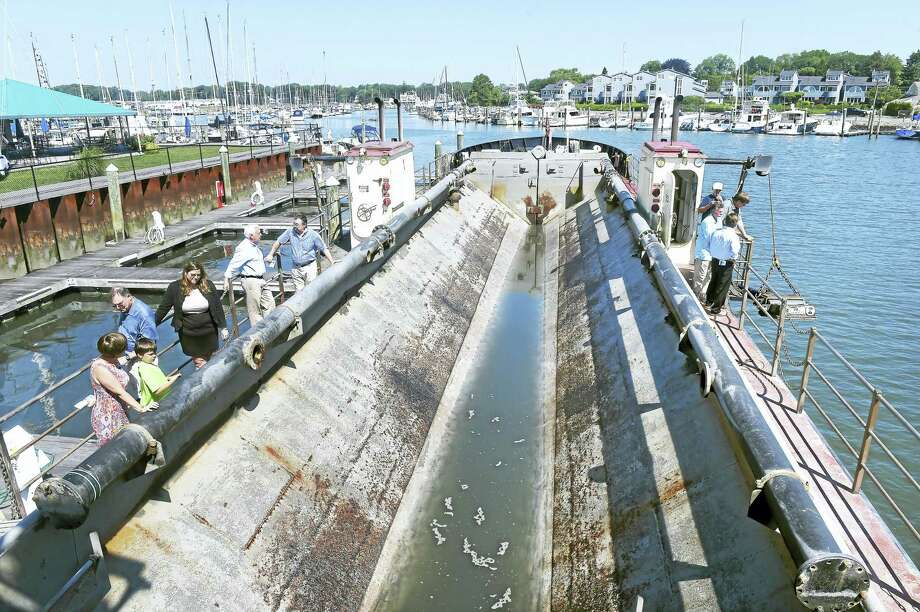 Arnold Gold-New Haven Register  People tour the Currituck, a shallow draft dredge, while docked at the Milford Yacht Club on 6/21/2016.  In the center is the hopper where dredged material is held before being deposited in another location.  The Currituck is currently dredging Milford Harbor. Photo: Journal Register Co.