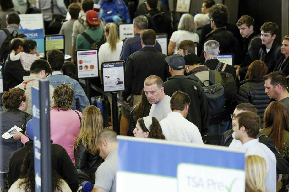 A long line of travelers at the TSA security checkpoint at O'Hare International Airport in Chicago on May 16. Photo: ASSOCIATED PRESS   / Copyright 2016 The Associated Press. All rights reserved. This material may not be published, broadcast, rewritten or redistribu