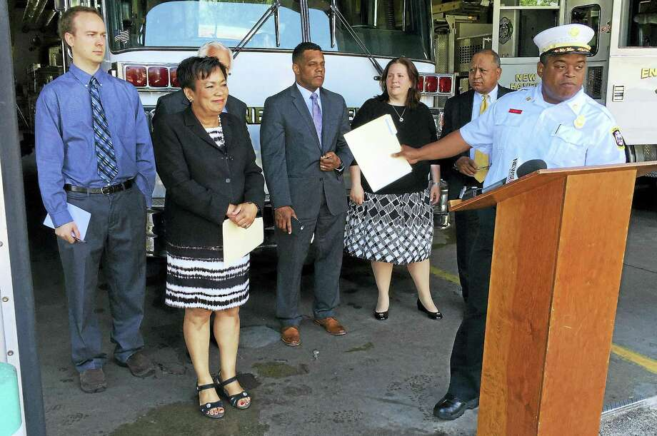 New Haven Acting Fire Chief Ralph Black, right, welcomes Mayor Toni Harp and other members of her administration during a press conference Tuesday at Fire Headquarters on Grand Avenue. Photo: Esteban L. Hernandez — New Haven Register