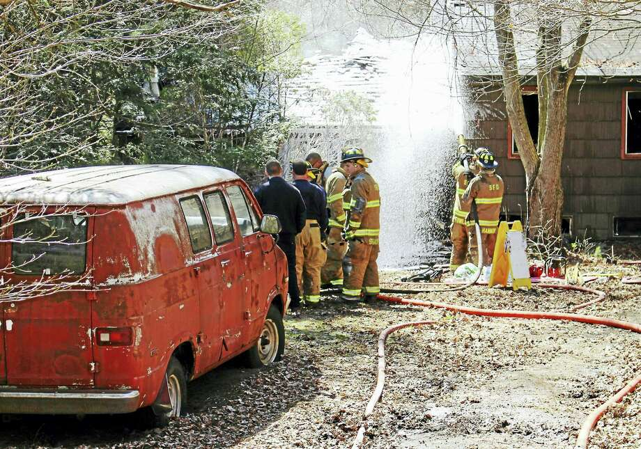 A man died Wednesday after he was pulled from a house fire at 9 Bungay Road in Seymour with a gunshot wound. Fire crews did CPR on the man and rushed him to the hospital, but he did not survive. Photo: Jean Falbo-Sosnovich — The New Haven Register