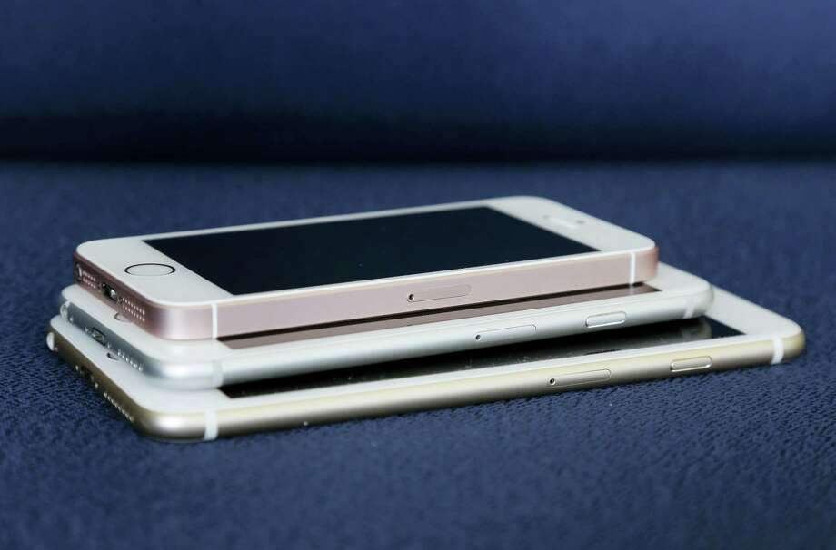 From bottom, the iPhone 6S Plus, 6S and SE lie stacked on one another. Photo: AP Photo/Julie Jacobson   / Copyright 2016 The Associated Press. All rights reserved. This material may not be published, broadcast, rewritten or redistributed without permission.