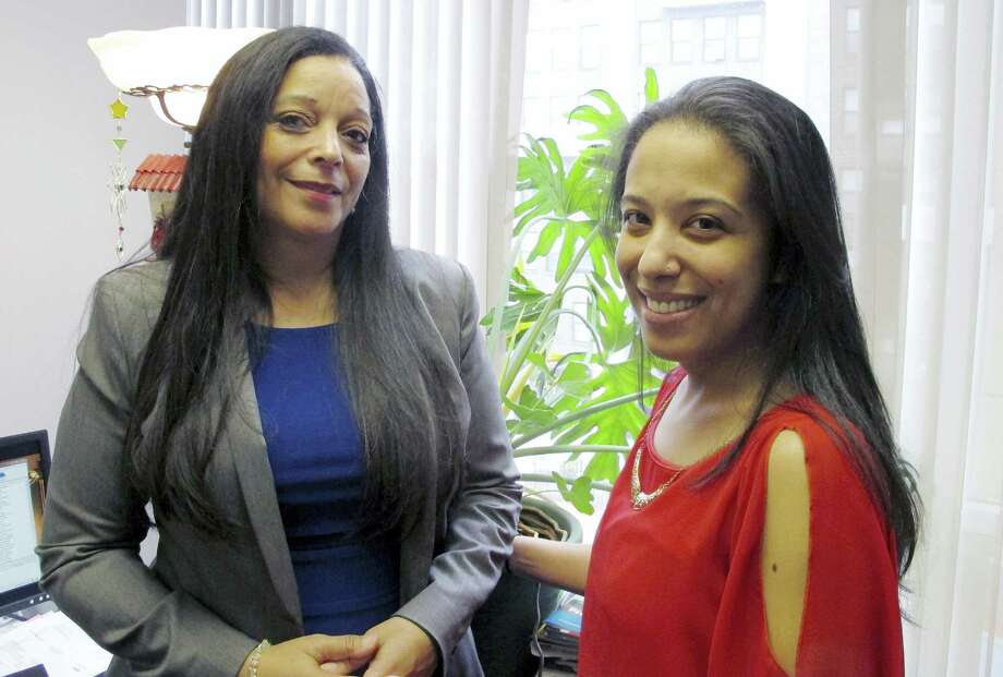 In this March 18, 2016 photo, Adelaida Torres, right, poses with her legal aid lawyer, Linda Allard, in Hartford, Conn., Torres believes she never would have won custody of her two daughters in 2013 during a bitter court fight with her now-ex-husband if not for the free legal help from Allard and Greater Hartford Legal Aid. Connecticut lawmakers are considering a bill that would create a task force to look into expanding the right to free lawyers for the poor in civil cases. Photo: AP Photo/Dave Collins   / AP