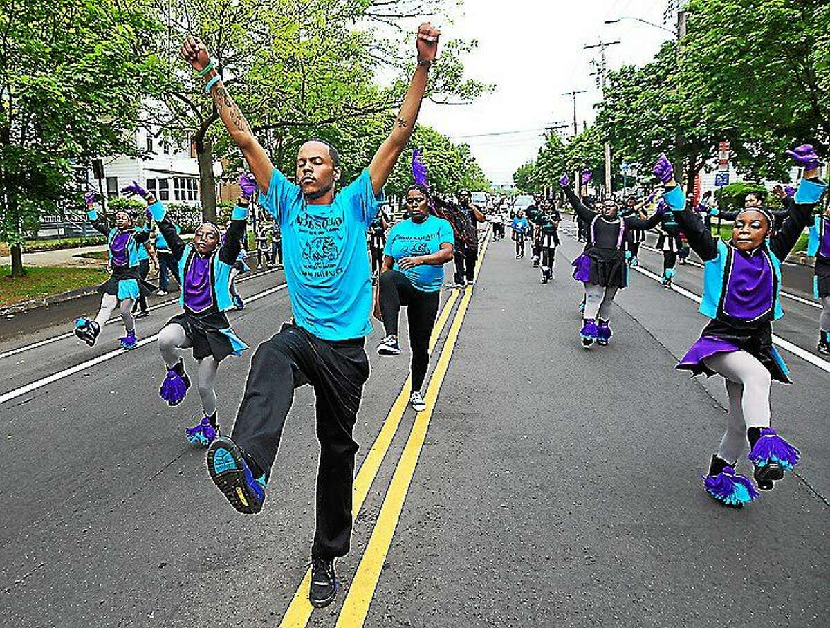 The Freddie Fixer Parade makes its way down Dixwell Avenue from Hamden to New Haven.