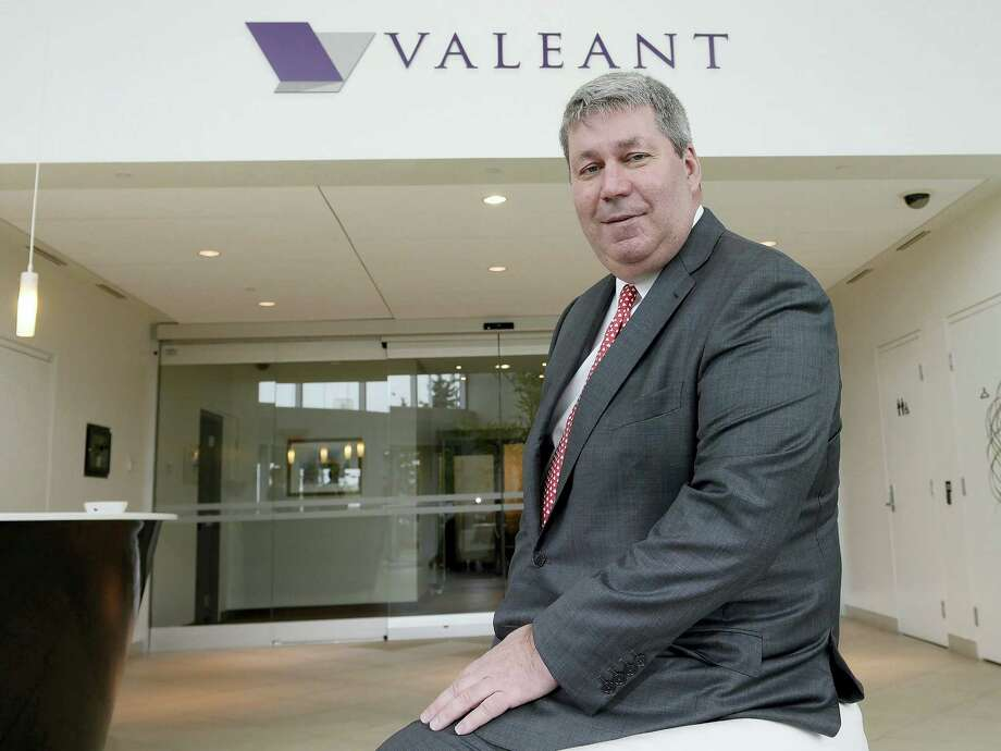 In this May 19, 2015 photo, Valeant Pharmaceuticals CEO J. Michael Pearson poses at the company's annual general meeting in Montreal. Senators investigating price hikes by Valeant Pharmaceuticals will question hedge fund manager William Ackman and former finance chief Robert Schiller at a hearing scheduled for April 27, 2016. Photo: Ryan Remiorz/The Canadian Press Via AP, File   / The Canadian Press
