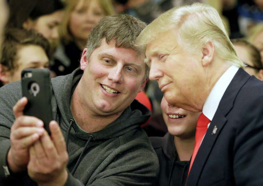 Mike Morrill takes a selfie with Republican presidential candidate Donald Trump during a rally Wednesday at the Radisson Paper Valley Hotel in Appleton, Wisconsin. Photo: Wm. Glasheen — The Post-Crescent Via AP   / The Post-Crescent