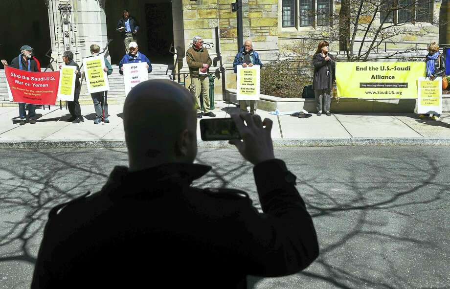 The Middle East Crisis Committee and Promoting Enduring Peace groups combine forces Wednesday to protest Saudi Arabia's involvement in the Yemeni civil war. They met outside the Yale Law School in New Haven because the school accepted a $10 million donation from a Saudi businessman to fund a center for the study of Islamic law. Photo: Peter Hvizdak — New Haven Register   / ?2016 Peter Hvizdak