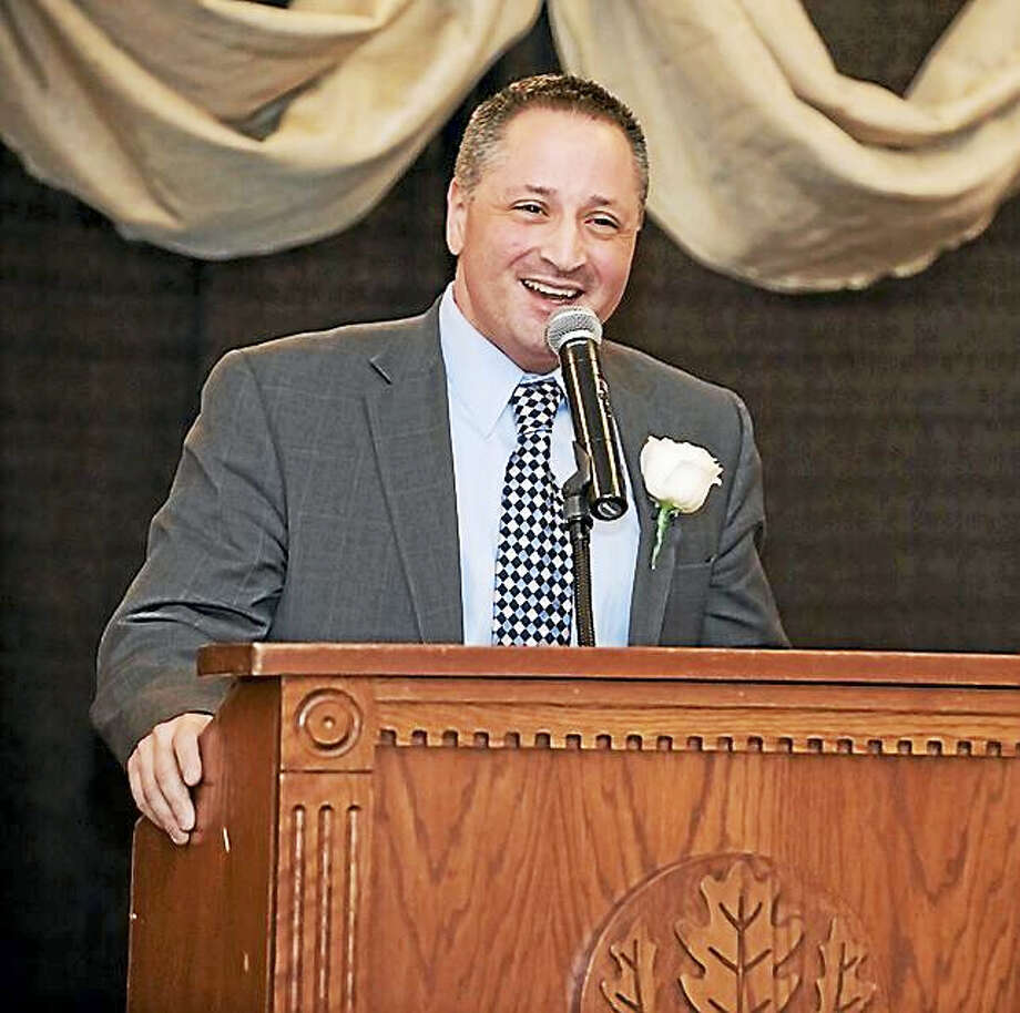 Wallingford Superintendent of Schools Salvatore Menzo stands at the podium during the 18th Annual Awards Celebration in Storrs earlier this month. Photo: Contributed Photo