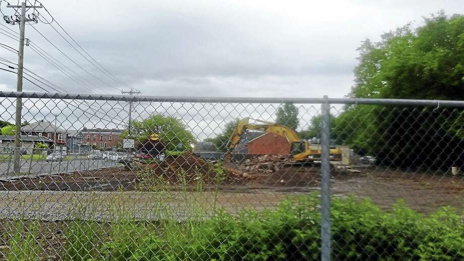 The Midas muffler building on Whitney Avenue was taken down Monday. Photo: Kate Ramunni — New Haven Register