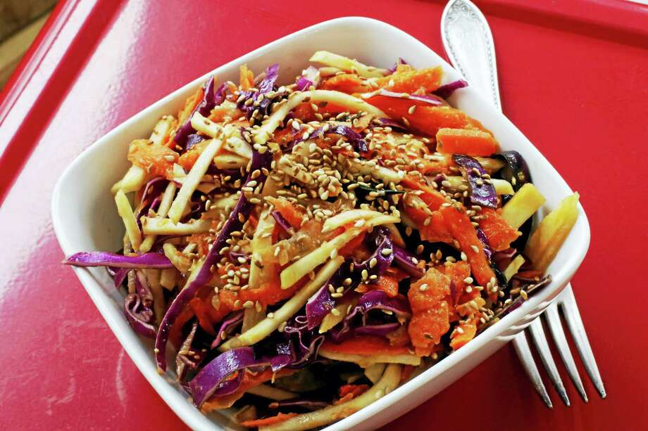 Instead of the more traditional mayonnaise-based dressing, this slaw recipe uses a ginger-miso mixture inspired by Japanese recipes. Photo: J.M. Hirsch — The Associated Press   / AP