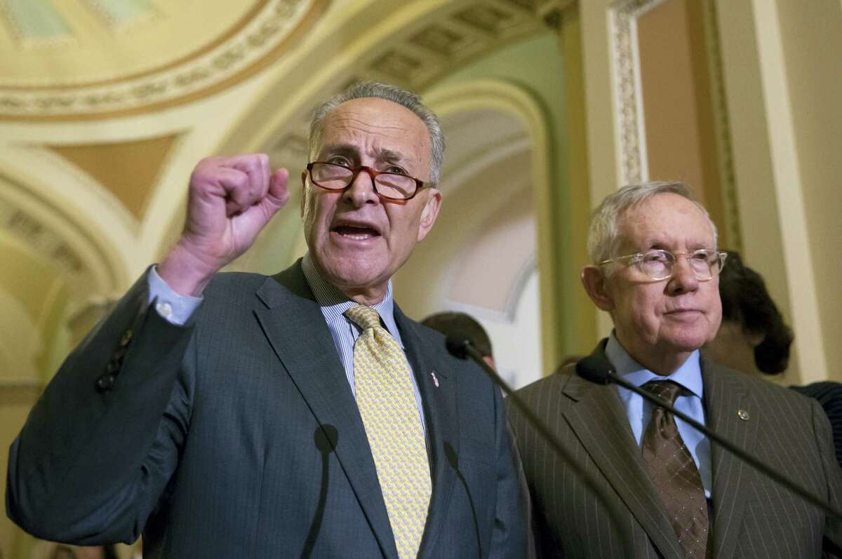 Sen. Charles Schumer, D-N.Y., joined at right by Senate Minority Leader Harry Reid of Nev., criticizes Republican lawmakers for being too tied to the NRA and the gun lobby, during a news conference on Capitol Hill in Washington on June 14, 2016.