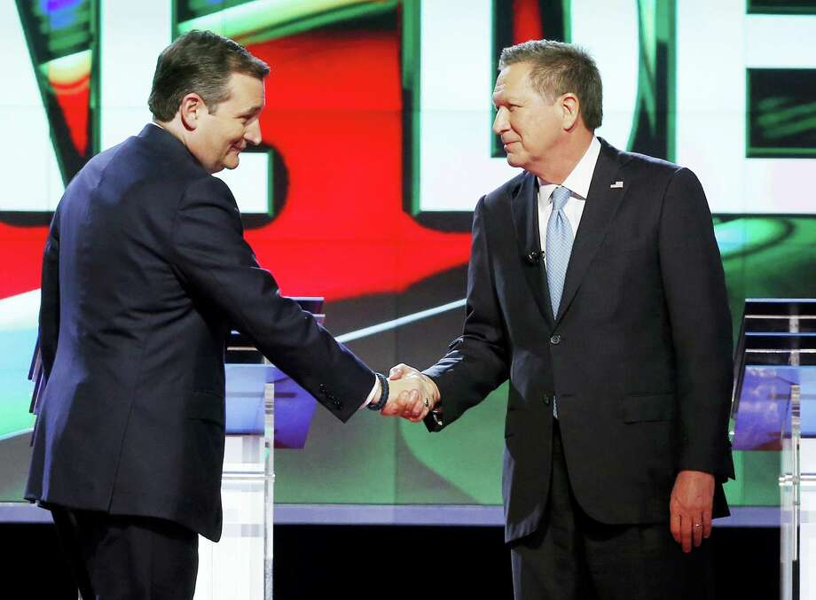 In this March 10, 2016, file photo, Republican presidential candidate, Sen. Ted Cruz, R-Texas, left, shakes hands with Republican presidential candidate, Ohio Gov. John Kasich, at the start of a Republican presidential debate sponsored by CNN, Salem Media Group and the Washington Times at the University of Miami in Coral Gables, Fla. The political world is waiting to see if Cruz and Kasich's alliance against Donald Trump proves brilliant or desperate. Some voters in the three states most affected are applauding the move and others are panning it. But many are struggling to understand what, if anything, it will mean for them. Photo: AP Photo/Wilfredo Lee, File    / Copyright 2016 The Associated Press. All rights reserved. This material may not be published, broadcast, rewritten or redistributed without permission.