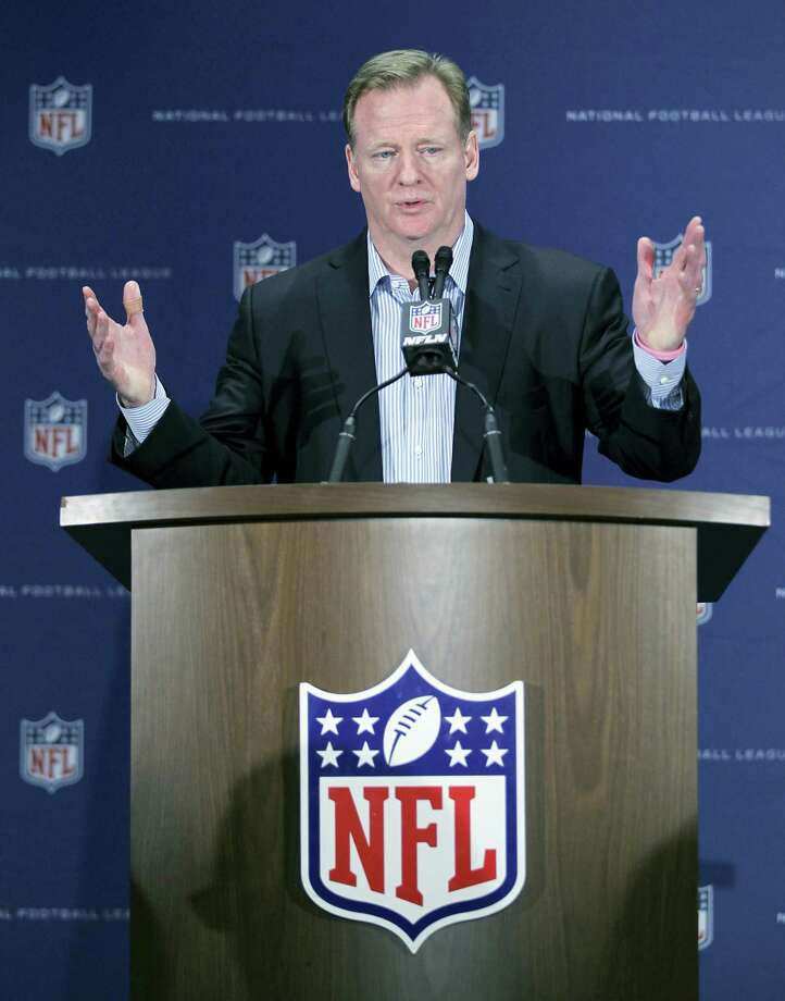 NFL Commissioner Roger Goodell gestures during a press conference. The NFL has demanded The New York Times retract a story that called the league's concussion research flawed and likened the NFL's handling of head trauma to the tobacco industry's response to the dangers of cigarettes. In a letter from its law firm to the general counsels of the newspaper and obtained by The Associated Press on Tuesday, the league said it was defamed by the Times. Photo: The Associated Press File Photo   / FR596 AP