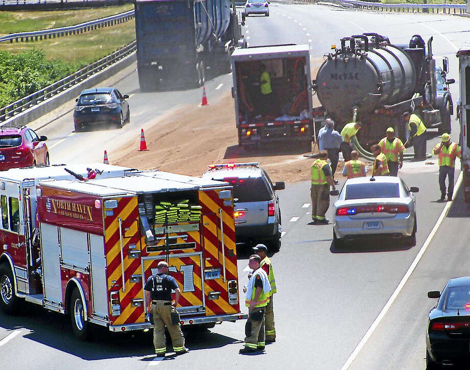 Part of Interstate 91 southbound was shut down for nearly two hours Monday after a tractor trailer crash that caused a fuel spill. The closure caused significant delays on local roads near highway on-ramps. Photo: (Wes Duplantier/The New Haven Register)