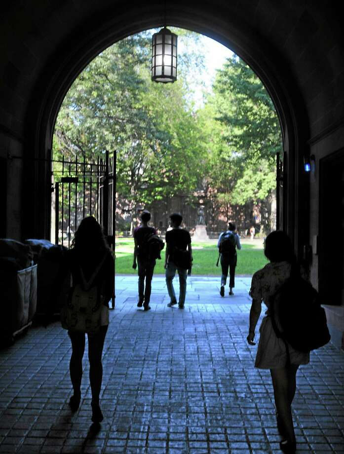 Despite the efforts of Florida Gov. Rick Scott, Yale's students will continue to call the Old Campus in New Haven home. Photo: PETER CASOLINO — NEW HAVEN REGISTER FILE PHOTO