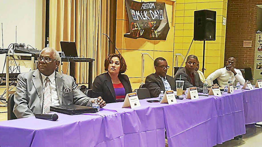 From left, panelists Reginald Mayo, former superintendent of New Haven schools; Maysa Akbar, founder and executive director of Integrated Wellness Group; Derrick Gordon of the Yale University Consultation Center; Brett Rayford of the state Department of Children and Families; Che Dawson, director of operations for Amistad Elementary School and member of the New Haven Board of Education; and Cornelius Finley, director of college and career readiness for Diploma Plus Inc., discuss the benefits of founding an all-boys school in New Haven. Photo: Shadhid Abdul-Karim — New Haven Register