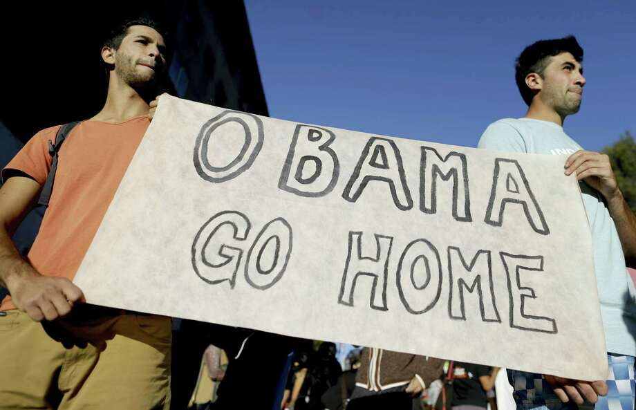 Demonstrators protest the visit of U.S. President Barack Obama on the 40th anniversary of the 1976 military coup that started Argentina's dictatorship, in Bariloche, Argentina, March 24. Human rights activists argue that the U.S. backed military dictatorships, including Argentina's regime. Photo: Natacha Pisarenko — The Associated Press   / AP