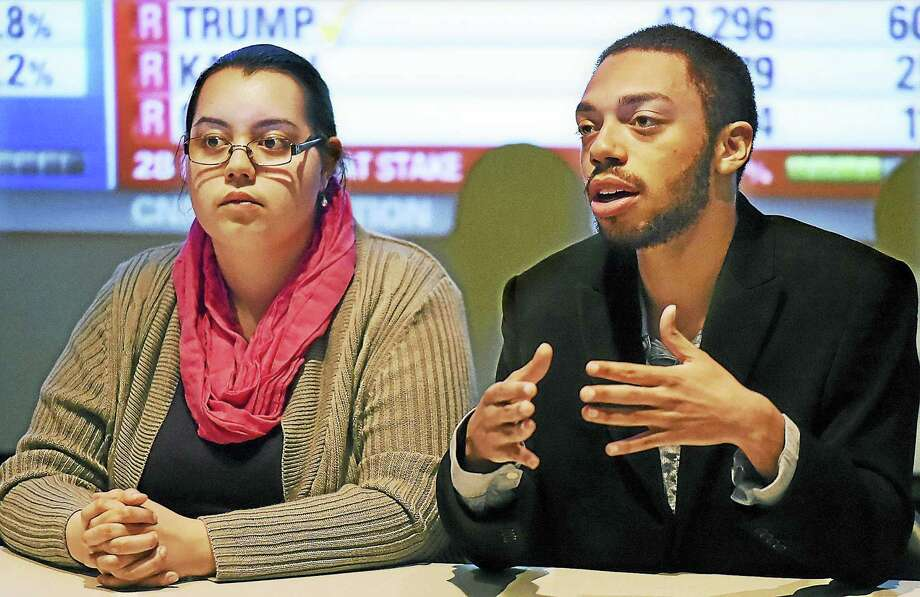 When asked if he would support Hillary Clinton, Southern Connecticut State University junior Corey Evans, at right, said although he supports Bernie Sanders, he would vote for Hillary Clinton if Clinton is the Democratic candidate. At left is Mishele Rodriguez, who also supports Bernie Sanders. Both are members of the College Democrats and served as panelists during a primary election viewing party, Tuesday, April 26, 2016, at SCSU in Engleman Hall. Photo: Catherine Avalone — New Haven Register      / New Haven RegisterThe Middletown Press