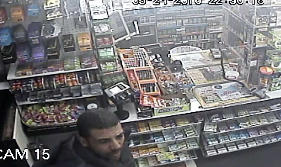 Ansonia police are asking for the public's help in identifying this man, who they say robbed a gas station at gunpoint Tuesday. Photo: Photo Courtesy Of The Ansonia Police Department