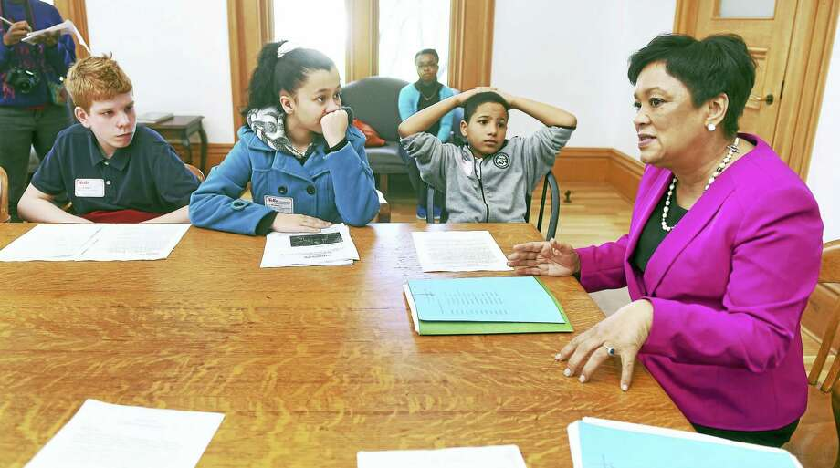 Truman School international students meet with New Haven Mayor Toni Harp, right, at City Hall in New Haven Tuesday. From left are Georgii Larkov of Russia, Bryan Bautista of the Dominican Republic and Alexandra Guzman of Puerto Rico. Photo: Arnold Gold — New Haven Register