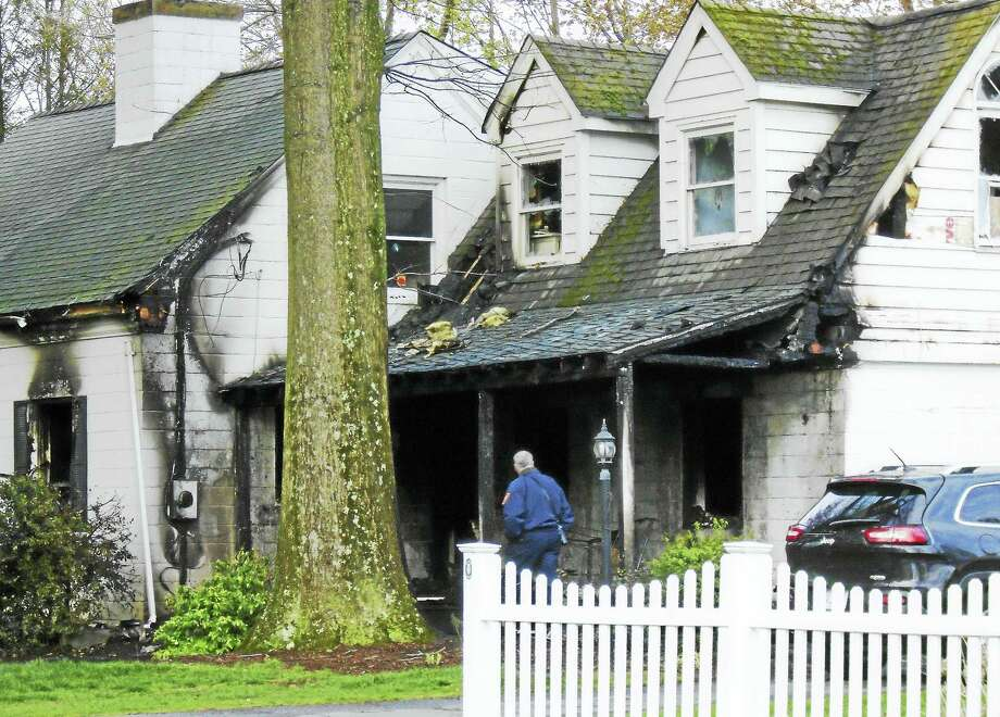 A fire reportedly sparked by downed electrical wires heavily damaged a home at 6 Green Hill Road in North Haven. A family inside escaped without injury. Photo: Wes Duplantier — The New Haven Register   / Copyright 2009