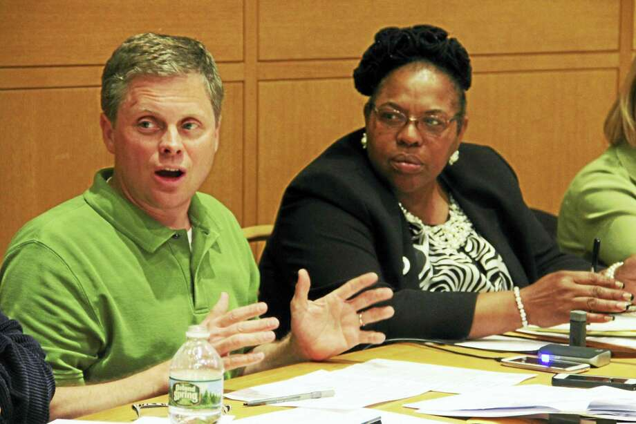 Aldermanic Finance Committee Vice Chairman Adam J. Marchand, D-25, talks while seated next to Chairwoman Alder Evette Hamilton, D-24, during the panel's deliberation on the city budget Monday at City Hall. Photo: Esteban L. Hernandez — New Haven Register