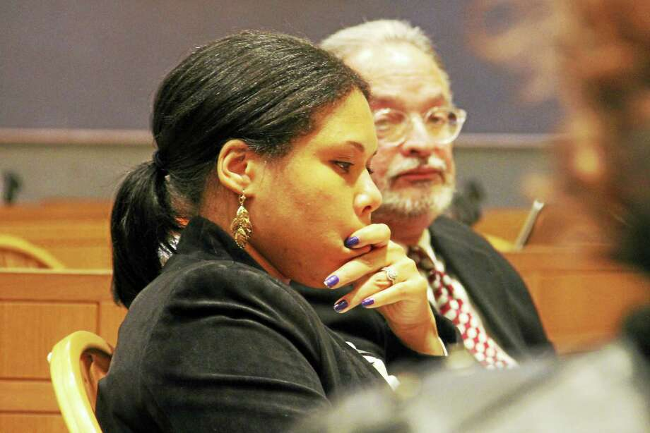 Mendi Blue, the city's director of development and policy, pauses during a Board of Alders Finance Committee budget workshop Tuesday at City Hall. At rear is Tomas Reyes, chief of staff for Mayor Toni Harp. Photo: Esteban L. Hernandez — New Haven Register