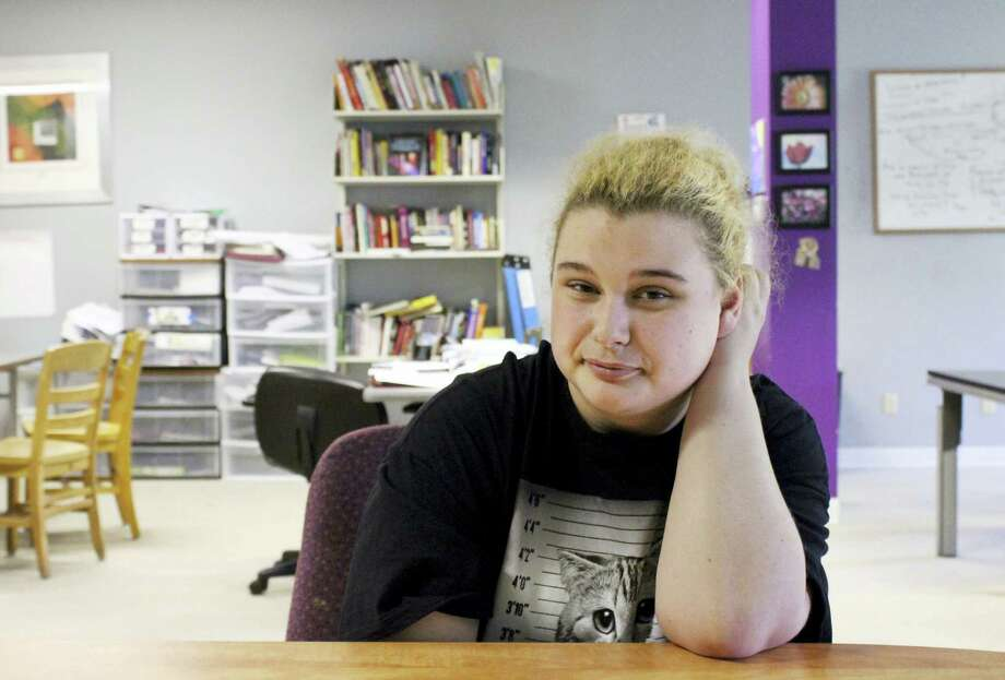 In this May 19, 2016 photo, Paige Petri, a student, poses at Horizon High School, a school that allows teens to get counseling and drug testing while they study alongside other recovering addicts, in Madison, Wis. Petri said she started smoking pot and getting high on cough medicine two years ago. Now a student at Horizon, she said she expects to graduate in a couple of years and that it likely wouldn'Äôt have been possible if not for the Madison school. Photo: AP Photo/Bryna Godar   / Copyright 2016 The Associated Press. All rights reserved. This material may not be published, broadcast, rewritten or redistribu