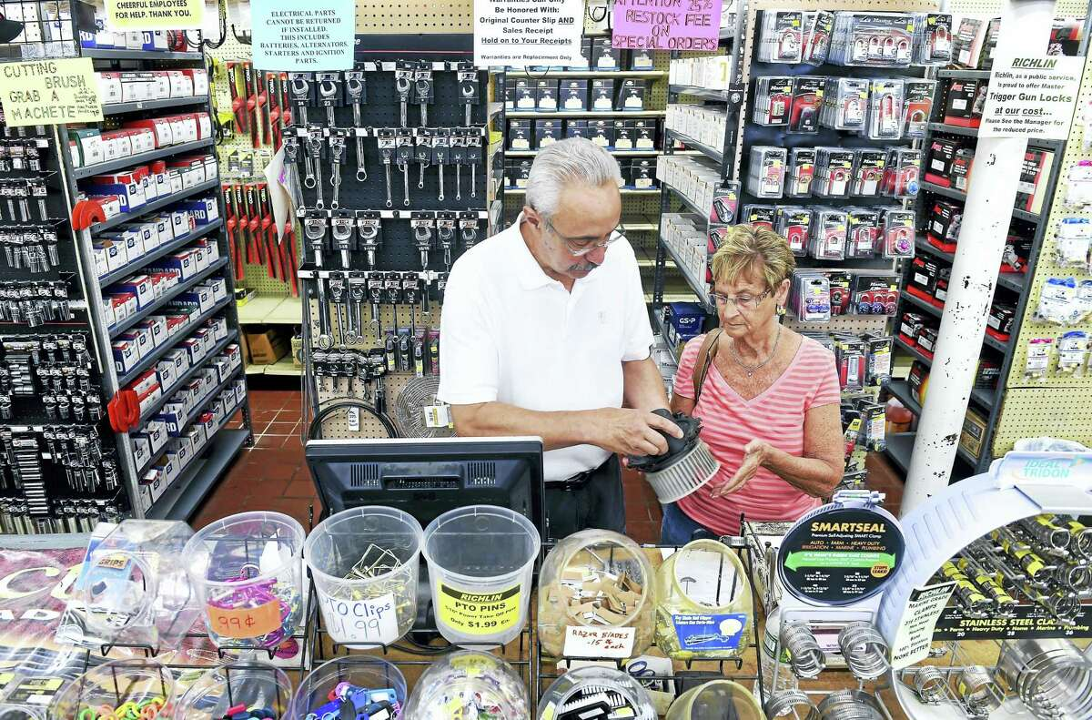Store manager Steve Milano assists Peggy Pongonis of Branford with a car part at the Richlin hardware/automotive/home and garden store in Branford on June 7.
