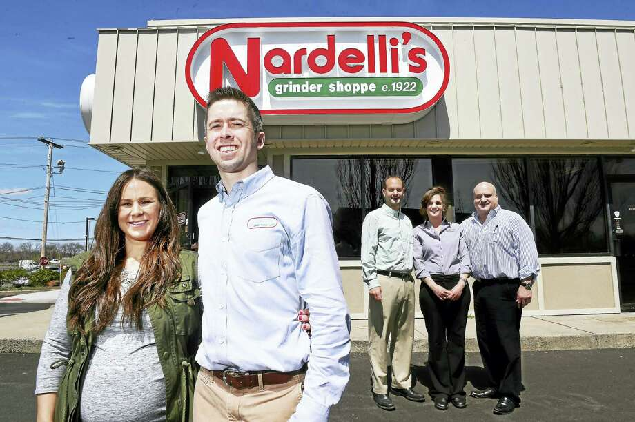 From left, Megan Linehan and her husband, Billy, are photographed in front of their new franchise of Nardelli's Grinder Shoppe in Milford. Behind them are the siblings Marco Nardelli, Diana Nardelli-Troiano and Tony Nardelli. Tony is the father of Megan Linehan. Photo: Arnold Gold — New Haven Register