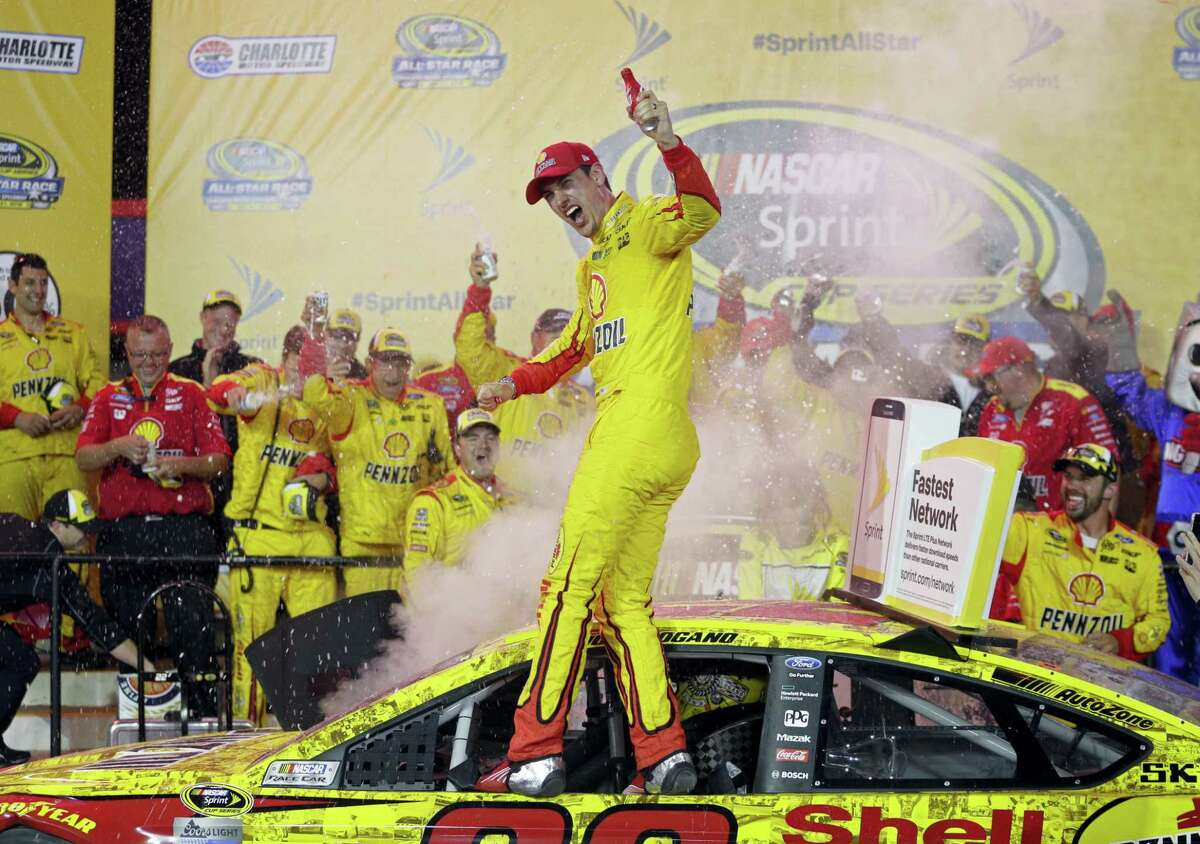 Joey Logano celebrates in Victory Lane after winning the NASCAR All-Star race at Charlotte Motor Speedway on Saturday.