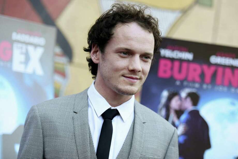 "In this June 11, 2015 photo, Anton Yelchin arrives at a special screening of ""Burying the Ex"" held at Grauman's Egyptian Theatre in Los Angeles. Yelchin, a charismatic and rising actor best known for playing Chekov in the new ""Star Trek"" films, has died at the age of 27. He was killed in a fatal traffic collision early Sunday morning, June 19, 2016, his publicist confirmed. Photo: Photo By Richard Shotwell/Invision/AP, File   / Invision"