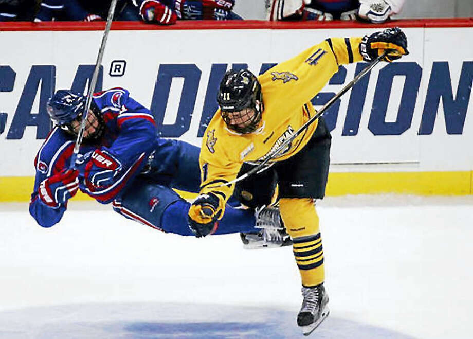 Quinnipiac's Tim Clifton (11) hits UMass Lowell's Chris Forney during the third period of the NCAA men's East Regional championship hockey game in Albany, N.Y. Photo: AP Photo/Mike Groll