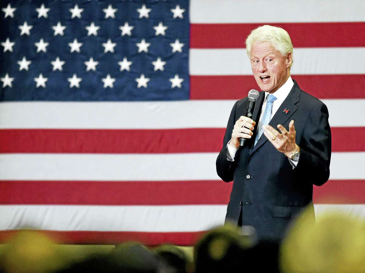 Former President Bill Clinton campaigns for his wife, Democratic presidential candidate Hillary Clinton ,during a stop at the Wilbur Cross High School in New Haven Monday with former Arizona Congresswoman Gabby Giffords and husband, retired astronaut and Navy Capt. Mark Kelly.