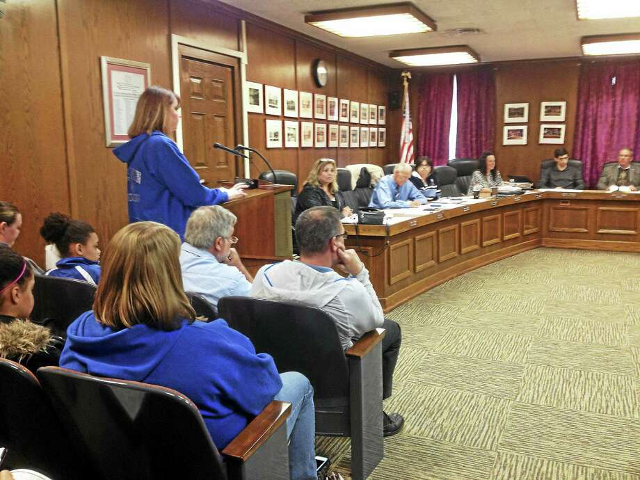 West Haven Seahawks Junior Pee Wee Cheerleading Coach Bridgette Hoskie, backed by other parents and several members of the team that took fifth place nationally, addresses the West Haven City Council Monday night. Photo: MARK ZARETSKY - NEW HAVEN REGISTER