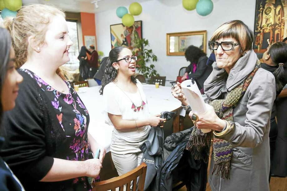 From left, Amayia Cordova, 16, Victoria Romprey, 15, and Ayana Rivera, 17, speak with U.S. Rep. Rosa DeLauro after a roundtable discussion with female business leaders at Manjares Restaurant & Fine Pastries in New Haven Monday. Photo: Arnold Gold — New Haven Register