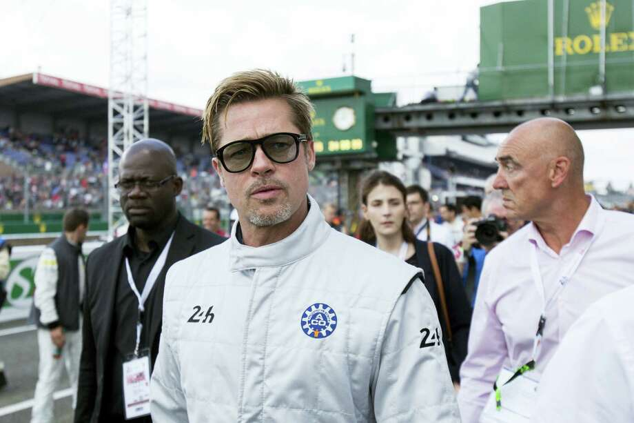Actor Brad Pitt arrives to start the 84th 24-hour Le Mans endurance race, in Le Mans, western France, Saturday, June 18, 2016. Photo: AP Photo/Kamil Zihnioglu    / Copyright 2016 The Associated Press. All rights reserved. This material may not be published, broadcast, rewritten or redistribu