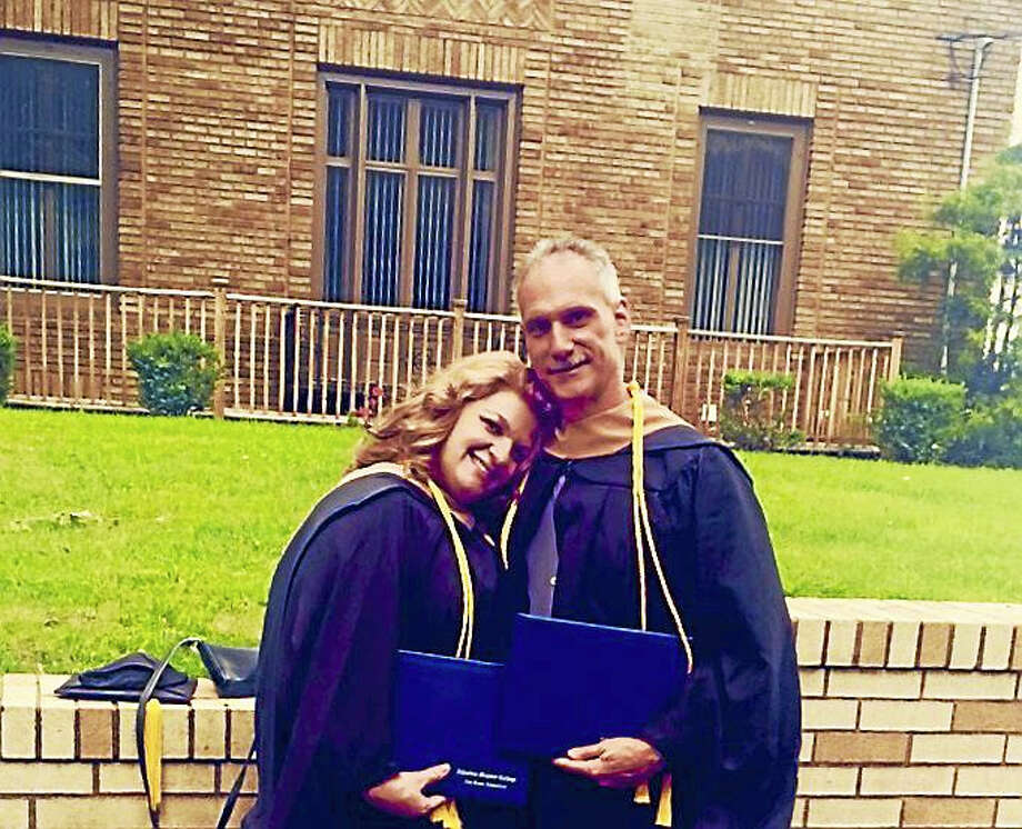 Andrea and James Salemme, married 30 years, graduated together Sunday from Albertus Magnus College. Photo: CONTRIBUTED PHOTO