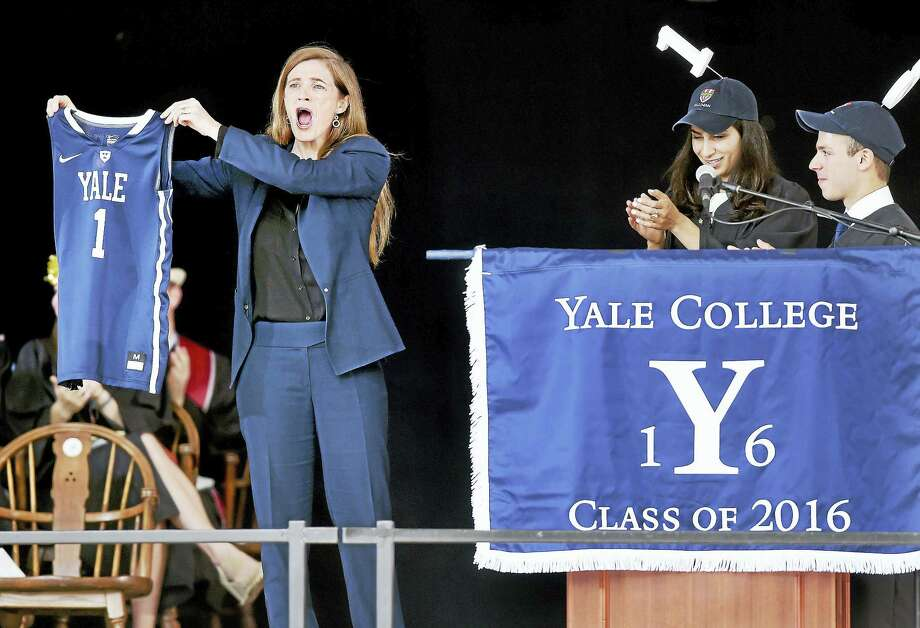U.S. Ambassador to the United Nations Samantha Power shows off a Yale women's basketball jersey given to her by Class Day Co-chairs Katayon Ghassemi and Benjamin Ackerman during Class Day Exercises for Yale University on Old Campus in New Haven Sunday. Photo: Arnold Gold — New Haven Register