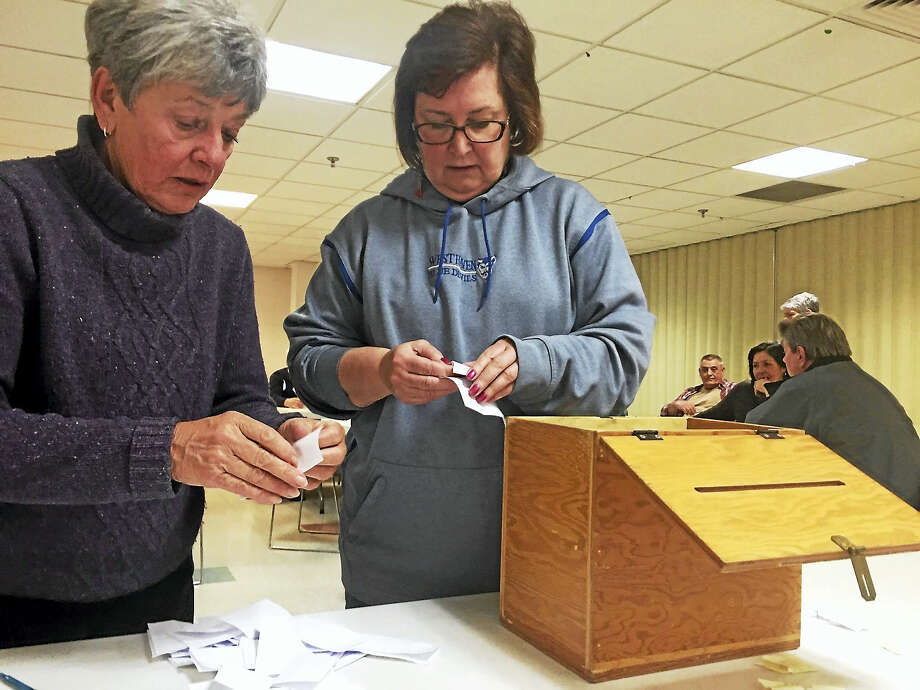 West Haven Republican Registrar of Voters Joanne Callegari, left, and GOP Board of Education member and temporary Republican Town Committee Chairwoman Patricia Libero count ballots at Thursday's caucus, at which Michele Gregorio was elected the town committee's new chairwoman. Photo: (Contributed Photo)