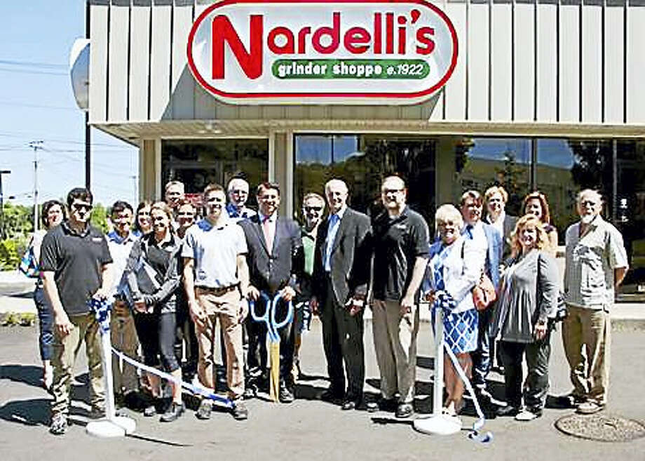 From left, Milford Mayor Benjamin Blake, Milford Regional Chamber of Commerce Executive Director Gary Mullin, Milford dignitaries, and friends and employees of Nardelli's Grinder Shoppe celebrate a ribbon-cutting at the business' new location in Milford June 14. The restaurant, offering deli and Italian food, grinders and more, is open from 9 a.m. to 9 p.m. Monday to Saturday; a special catering menu is available. For information, call 203-693-2227 or visit nardellis.com. Photo: CONTRIBUTED PHOTO — S.M. Cooper Photography